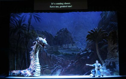 Tamino is attacked by the serpent in Sarasota Opera's 2004 production of The Magic Flute (Stage Director: William Gustason Set Designer: Troy Hourie)